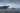 """ТАРКР Пётр Великий в Кронштадте. На заднем плане форт Император Александр I """"Чумный""""."""
